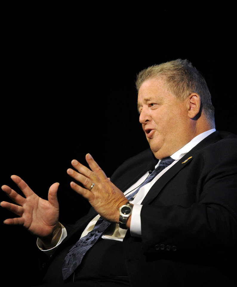 Kansas head coach Charlie Weis gestures at NCAA college football Big 12 Media Days, Tuesday, July 24, 2012, in Dallas. (AP Photo/Matt Strasen)
