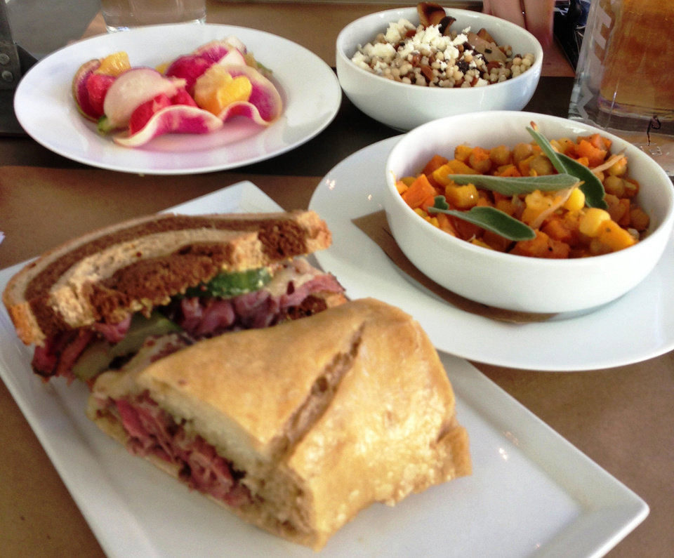 Photo - A sampling of foods from Kitchen 324, including Hand-Carved, Double-Dipped Beef Tenderloin Sandwich, Citrus Salad with Radishes, Israeli Couscous with Wild Mushrooms and Feta, and Fall Succotash.  DAVE CATHEY - THE OKLAHOMAN