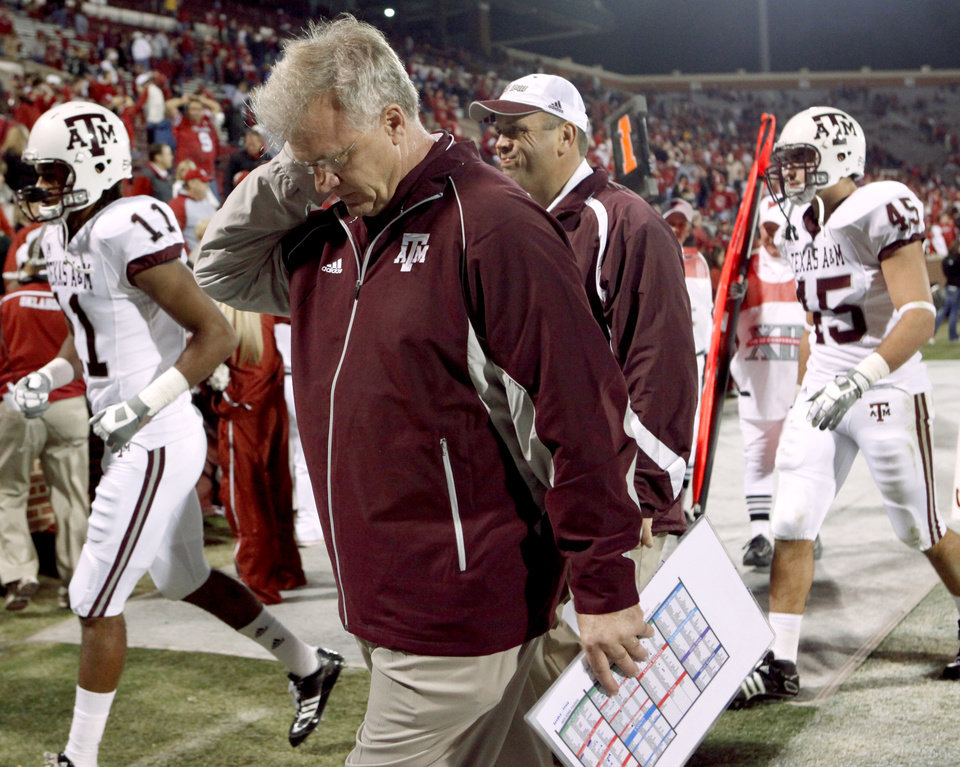 Photo - Texas A&M coach Mike Sherman walks off the field after the Big 12 college football game between the University of Oklahoma Sooners and the Texas A&M Aggies at Gaylord Family - Oklahoma Memorial Stadium in Norman, Okla., Saturday, November 14, 2009.  Photo by Bryan Terry, The Oklahoman