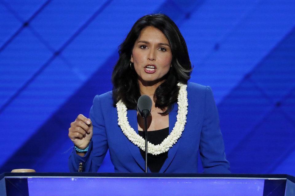 Photo - Rep. Tulsi Gabbard, D-HI., nominates Sen. Bernie Sanders, I-VT., for President of the United States during the second day of the Democratic National Convention in Philadelphia , Tuesday, July 26, 2016. (AP Photo/J. Scott Applewhite)