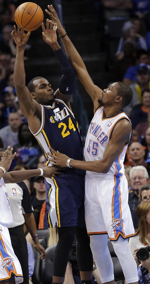 Photo - Oklahoma City Thunder's Kevin Durant (35) defends on Utah Jazz's Paul Millsap (24) during the NBA basketball game between the Oklahoma City Thunder and the Utah Jazz at Chesapeake Energy Arena on Wednesday, March 13, 2013, in Oklahoma City, Okla. Photo by Chris Landsberger, The Oklahoman