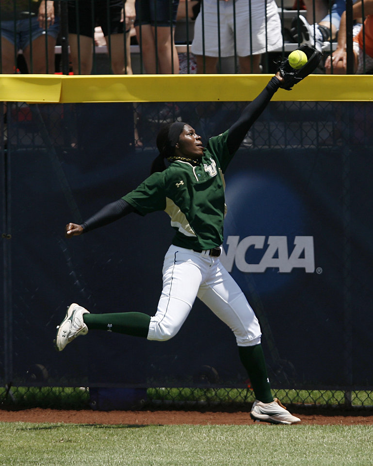 USF's Janine Richardson (11) misses a catch during a Women's College World Series game between Louisiana State University and the University of South Florida at ASA Hall of Fame Stadium in Oklahoma City, Saturday, June 2, 2012. Photo by Garett Fisbeck, The Oklahoman