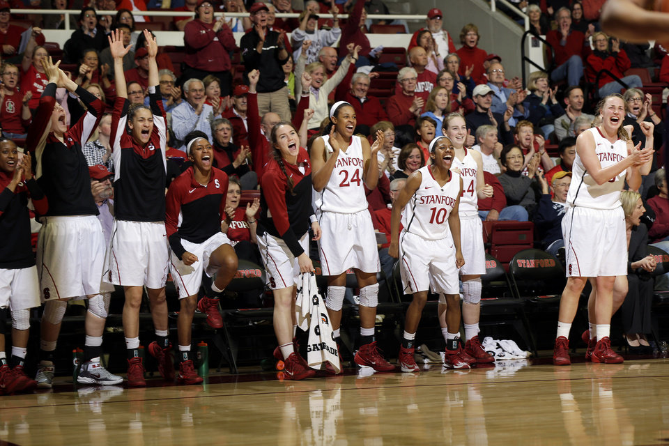 Photo - Stanford players celebrate from the bench in the closing minutes of a 83-60 win over Washington during the second half of an NCAA college basketball game on Thursday, Feb. 27, 2014, in Stanford, Calif. (AP Photo/Marcio Jose Sanchez)
