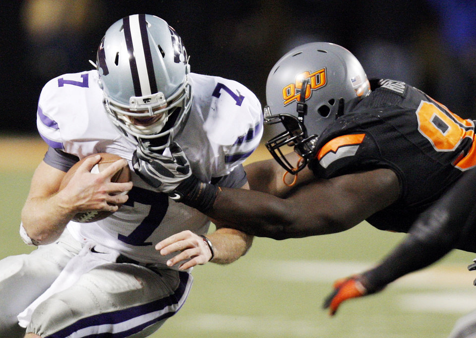 OSU's Anthony Rogers gets some of the face mask of KSU quarterback Collin Klein (7) in the fourth quarter during a college football game between the Oklahoma State University Cowboys (OSU) and the Kansas State University Wildcats (KSU) at Boone Pickens Stadium in Stillwater, Okla., Saturday, Nov. 5, 2011. OSU won, 52-45. Photo by Nate Billings, The Oklahoman ORG XMIT: KOD