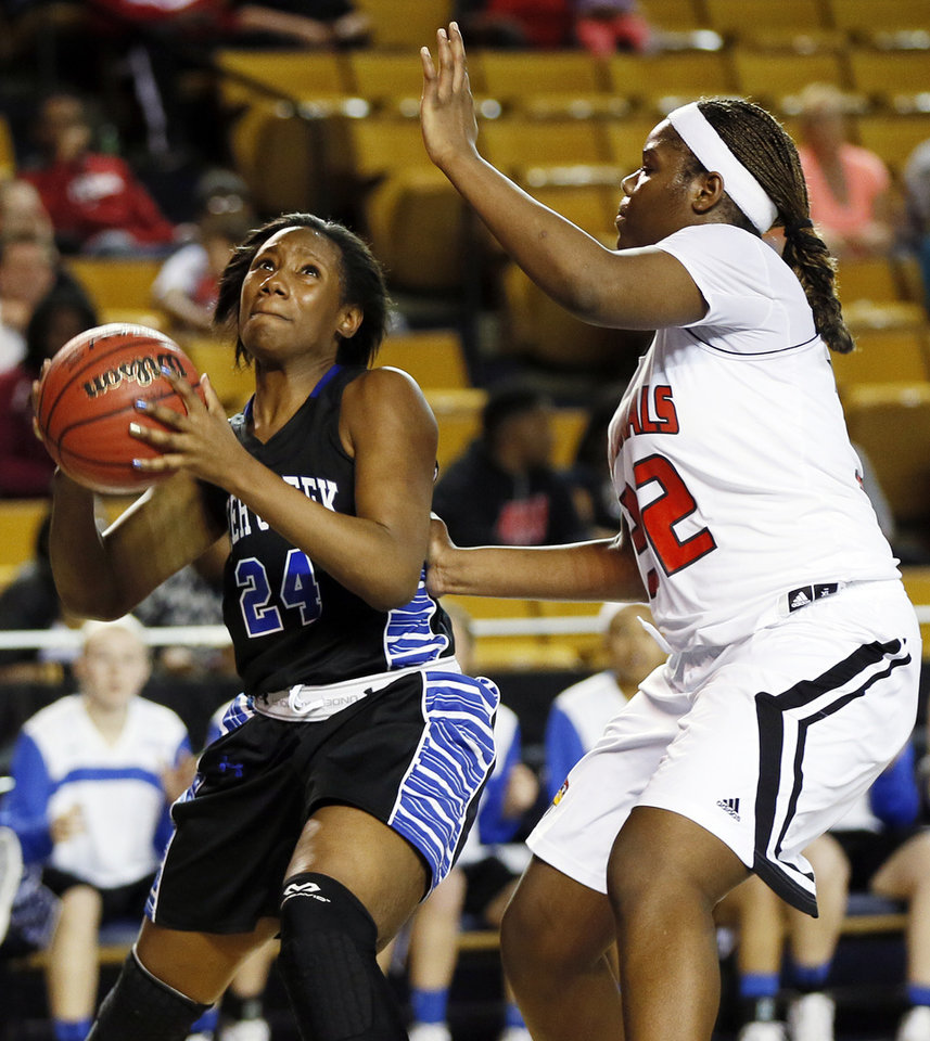 Photo - Deer Creek's Dakota Vann (24) takes a shot against East Central's Sharayla Brown (32) during the Class 5A girls championship game in the state high school basketball tournament between Deer Creek and Tulsa East Central at the Mabee Center in Tulsa, Okla., Saturday, March 15, 2014. Deer Creek won, 31-28. Photo by Nate Billings, The Oklahoman