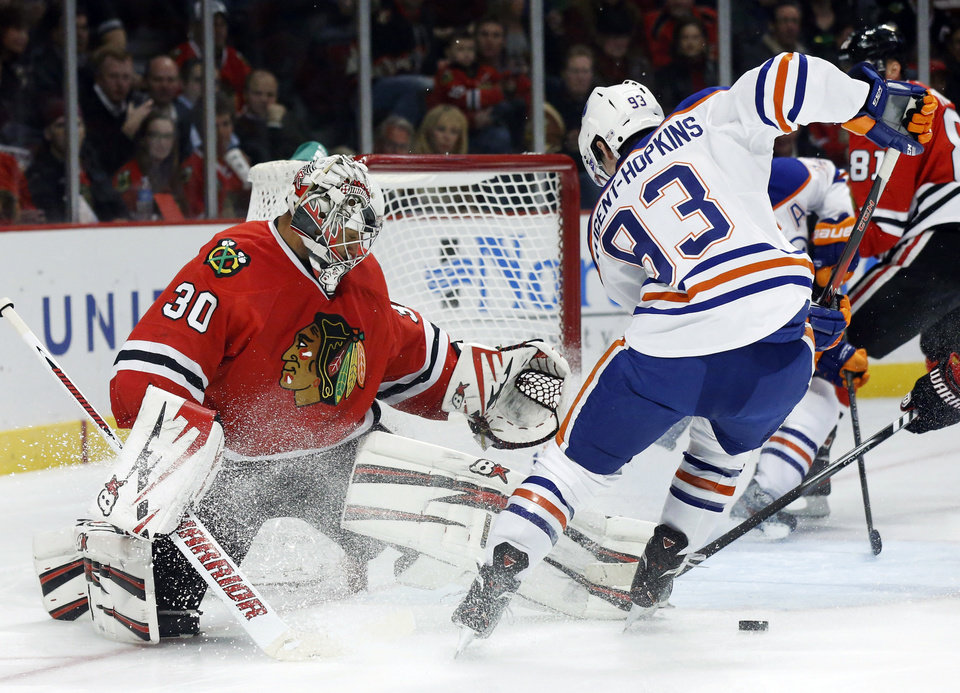 Edmonton Oilers forward Ryan Nugent-Hopkins (93) is unable to get a rebound shot on Chicago Blackhawks goalie Ray Emery (30) during the first period of an NHL hockey game, Monday, Feb. 25, 2013, in Chicago. (AP Photo/Charles Rex Arbogast)
