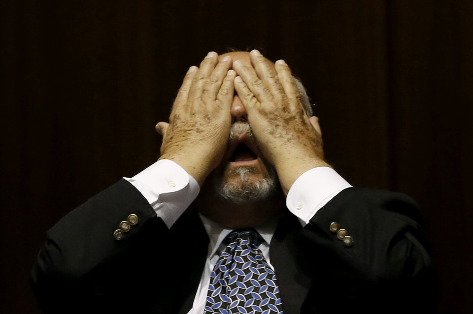 Photo - Rep. Macario Saldate, D-Tucson, rubs his eyes during a special session budget battle for Medicaid funding on Wednesday, June 12, 2013, in Phoenix.  The Arizona Legislature is on track to pull an all-nighter and work into Thursday to finish a state budget and approve Medicaid expansion. (AP Photo/Ross D. Franklin)