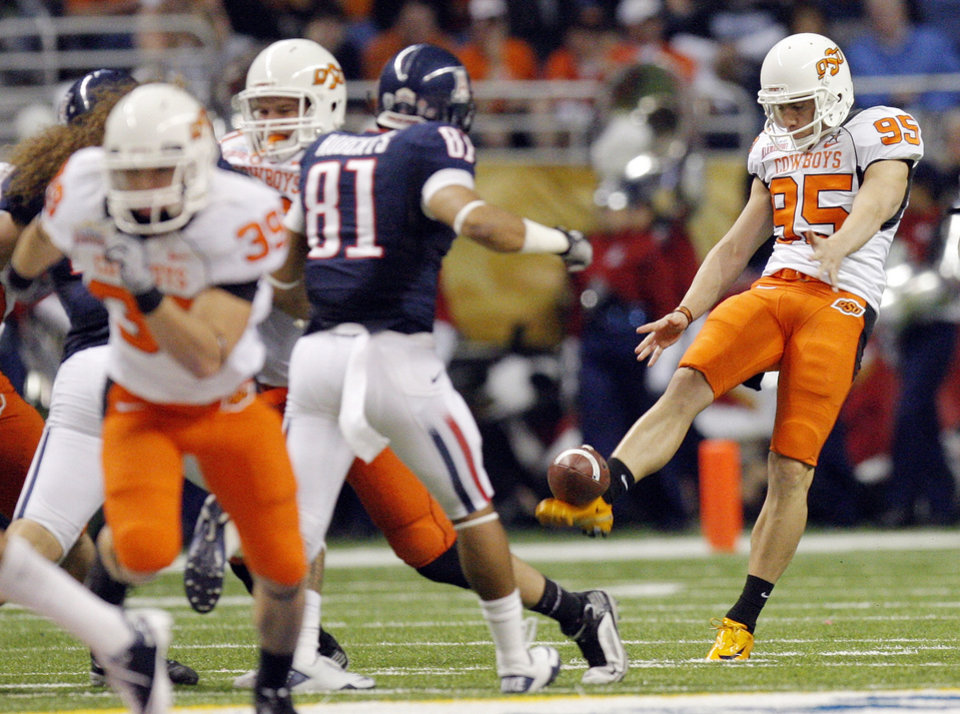 Photo - OSU's Dan Bailey (95) punts during the Valero Alamo Bowl college football game between the Oklahoma State University Cowboys (OSU) and the University of Arizona Wildcats at the Alamodome in San Antonio, Texas, Wednesday, December 29, 2010. Photo by Nate Billings, The Oklahoman