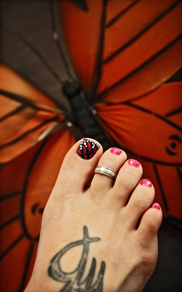 Photo - A Monarch butterfly wing is an eyecatching motif for your fingernails or toenails. Nail art by Eryn Dieutt-Brothers of Cottonwood Salon Spa. Photo by Chris Landsberger, The Oklahoman.  CHRIS LANDSBERGER