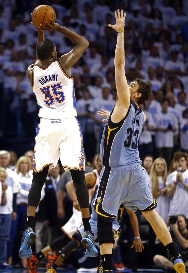 Photo - Oklahoma City's Kevin Durant (35) takes the last shot of overtime as Memphis' Marc Gasol (33) defends during Game 5 in the first round of the NBA playoffs between the Oklahoma City Thunder and the Memphis Grizzlies at Chesapeake Energy Arena in Oklahoma City, Tuesday, April 29, 2014. Photo by Sarah Phipps, The Oklahoman