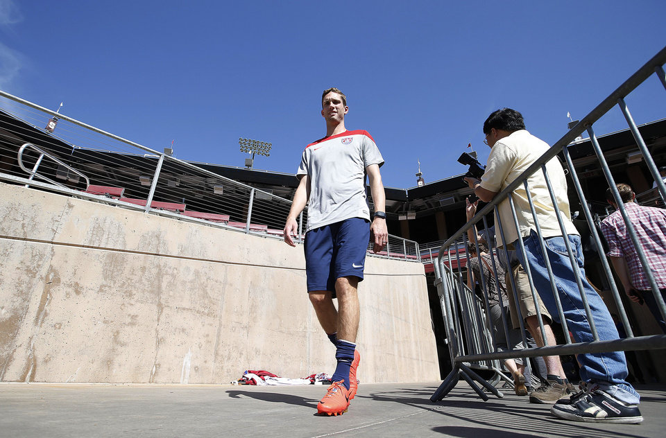 Photo - Clarence Goodson, of the US Men's National soccer team walks out onto the field during a training session on Wednesday, May 14, 2014, Stanford, Calif.  The US national soccer team kicked off its preparation camp at Stanford University preparing for the World Cup tournament, which gets underway in June. (AP Photo/Tony Avelar)