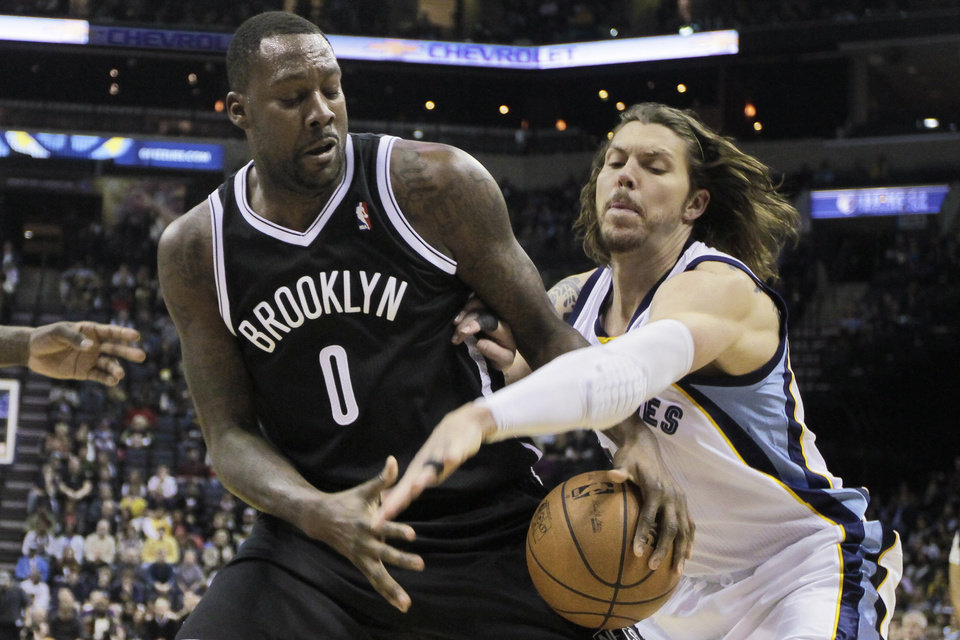 Photo - Memphis Grizzlies' Mike Miller, right, tries to strip the ball away from Brooklyn Nets' Andray Blatche (0) in the first half of an NBA basketball game in Memphis, Tenn., Saturday, Nov. 30, 2013. (AP Photo/Danny Johnston)