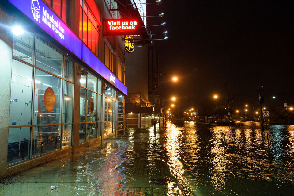 Photo -   This photo provided by Dylan Patrick shows flooding along the Westside Highway near the USS Intrepid as Sandy moves through the area Monday, Oct. 29, 2012 in New York. Much of New York was plunged into darkness Monday by a superstorm that overflowed the city's historic waterfront, flooded the financial district and subway tunnels and cut power to nearly a million people. (AP Photo/Dylan Patrick) MANDATORY CREDIT: DYLAN PATRICK