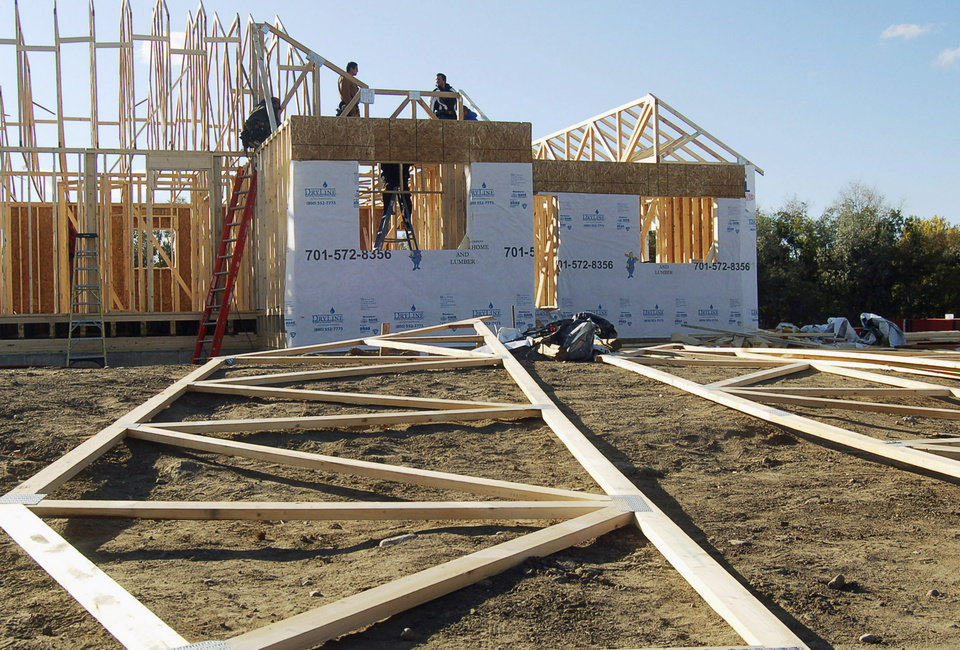 Photo - FILE - This Oct. 21, 2011 file photo shows workmen at an apartment building under construction in Williston, N.D. The AFL-CIO, the nation's largest labor federation, says the state's death rate of 97.4 per 100,000 in the construction industry in 2012 was nearly 10 times the national average in that field. It also said the death rate for oil, gas and mining workers in North Dakota was more than six times the national average in 2012. (AP Photo/James MacPherson, File)