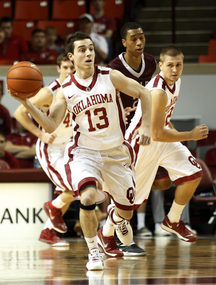 Oklahoma\'s James Fraschilla (13) passes the ball downcourt during a mens basketball game between OU and UALR at Lloyd Noble Center in Norman, Okla., Friday, Nov. 29, 2013. Photo by Garett Fisbeck, For The Oklahoman
