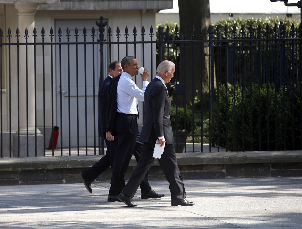 Photo - President Barack Obama walks with Vice President Joe Biden and former Procter and Gamble executive Robert McDonald, the nominee as the next Veterans Affairs secretary, in front of the White House as they walked from the Department of Veterans Affairs in Washington, Monday, June 30, 2014. If confirmed by the Senate, McDonald would succeed Eric Shinseki, the retired four-star general who resigned last month as the scope of the issues at veterans' hospitals became apparent. (AP Photo/Charles Dharapak)