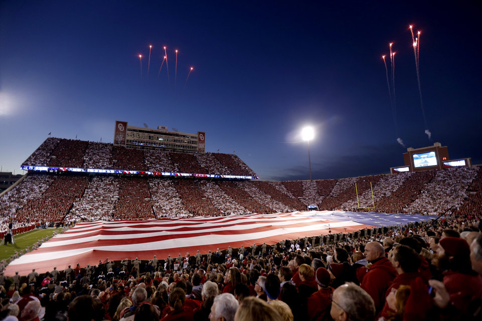 Photo - The crowd cheers before the college football game between the University of Oklahoma Sooners (OU) and the Notre Dame Fighting Irish at Gaylord Family-Oklahoma Memorial Stadium in Norman, Okla., Saturday, Oct. 27, 2012. Photo by Bryan Terry, The Oklahoman