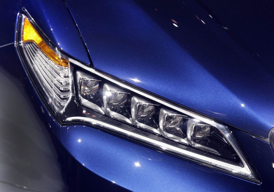 Photo - This photo shows the headlight array that features five bulbs on the 2015 Acura TLX, at the 2014 New York International Auto Show, at the Javits Convention Center, in New York, Wednesday, April 16, 2014. (AP Photo/Richard Drew)