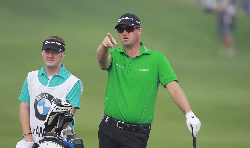 Photo -   Peter Hanson from Sweden gestures on the 4th fairway during the final round of the Masters golf tournament in Shanghai, China on Sunday Oct. 28, 2012. (AP Photo)
