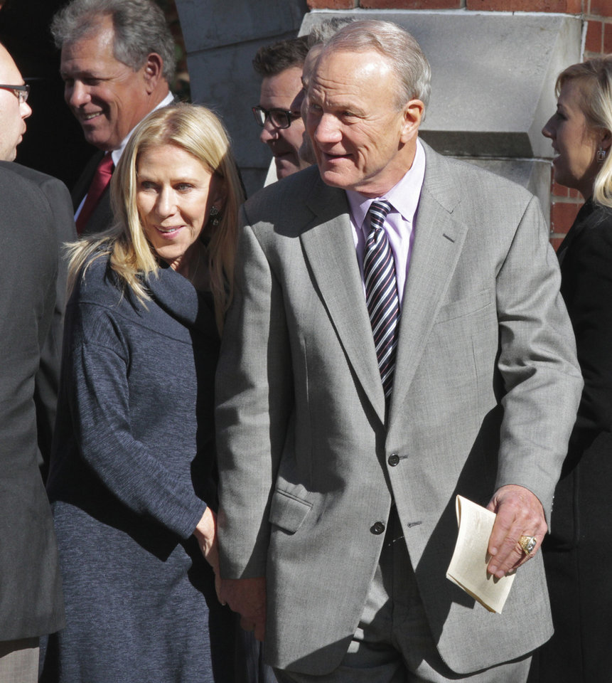 <strong>2011: Switzer at funeral of Bob Barry Sr.</strong><br> In this 2011 photos, Switzer and his wife, Becky, leave the funeral of former OU play-by-play man Bob Barry Sr. PHOTO BY STEVE SISNEY, The Oklahoman Archives