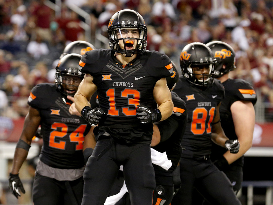 Photo - Oklahoma State's David Glidden (13) celebrates his touchdown in the 3rd quarter of the college football game between Oklahoma State University (OSU) and Florida State University (FSU) at the AdvoCare Cowboys Classic at At&T Stadium in Arlington, Texas,  Saturday, Aug. 30, 2014. Photo by Sarah Phipps, The Oklahoman