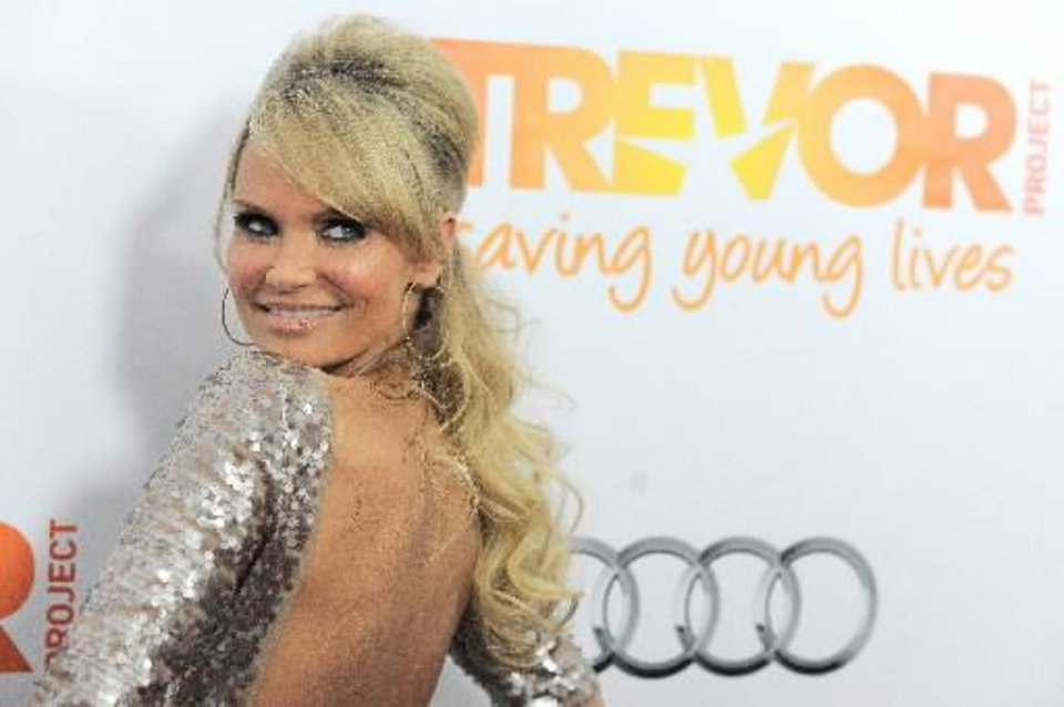 "Kristin Chenoweth arrives at the ""Trevor Live"" benefit show at the Hollywood Palladium on Sunday, Dec. 2, 2012, in Los Angeles. (AP)"