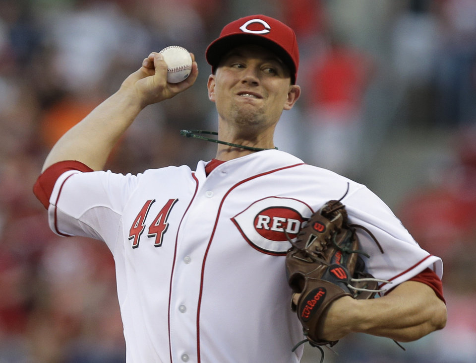 Photo - Cincinnati Reds starting pitcher Mike Leake throws against the St. Louis Cardinals in the first inning of a baseball game, Sunday, May 25, 2014, in Cincinnati. (AP Photo/Al Behrman)