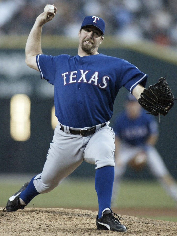 MAJOR LEAGUE BASEBALL PLAYER: Texas Rangers starting pitcher R.A. Dickey delivers against the Detroit Tigers in the fifth inning Wednesday, Aug. 20, 2003, in Detroit. Dickey (8-5) threw a six-hitter for his first major league shutout in their 6-0 win. (AP Photo/Duane Burleson)