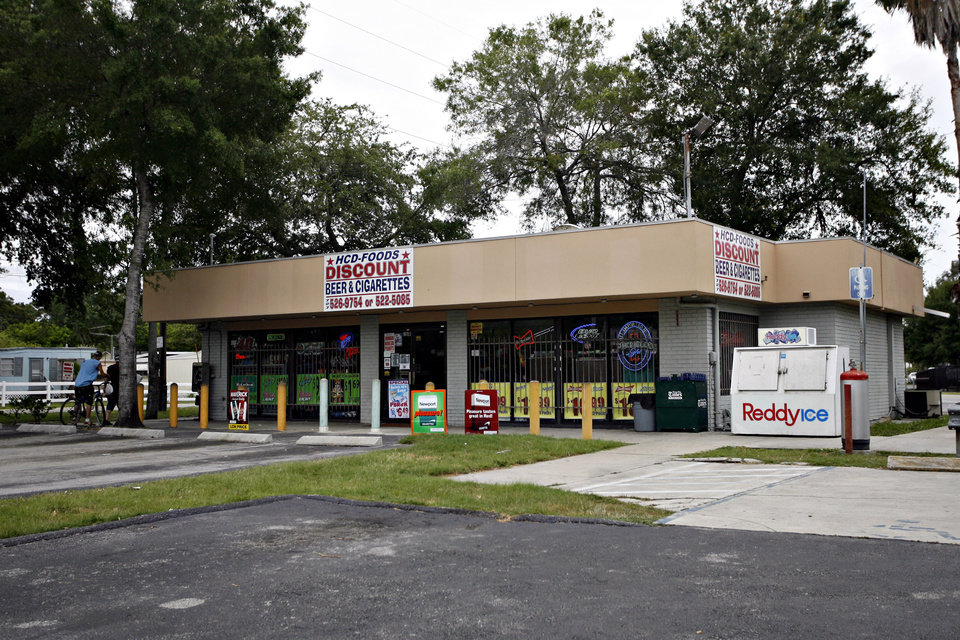 Photo -   This Friday, June 22, 2012, photo shows the Haines County Beverage Depot where Anthony Giancola reportedly began his rampage, in Lealman, Fla., on Friday. Authorities said Giancola, an ex-Tampa Bay-area middle school principal who lost his job over a drug arrest five years ago, went on a rampage Friday, stabbing several people, killing at least two. Authorities said there were 11 victims in all, and several are being treated at area hospitals for injuries ranging from minor to life-threatening. (AP Photo/Tampa Bay Times, Melissa Lyttle) TAMPA OUT; CITRUS COUNTY OUT; PORT CHARLOTTE OUT; BROOKSVILLE HERNANDO TODAY OUT