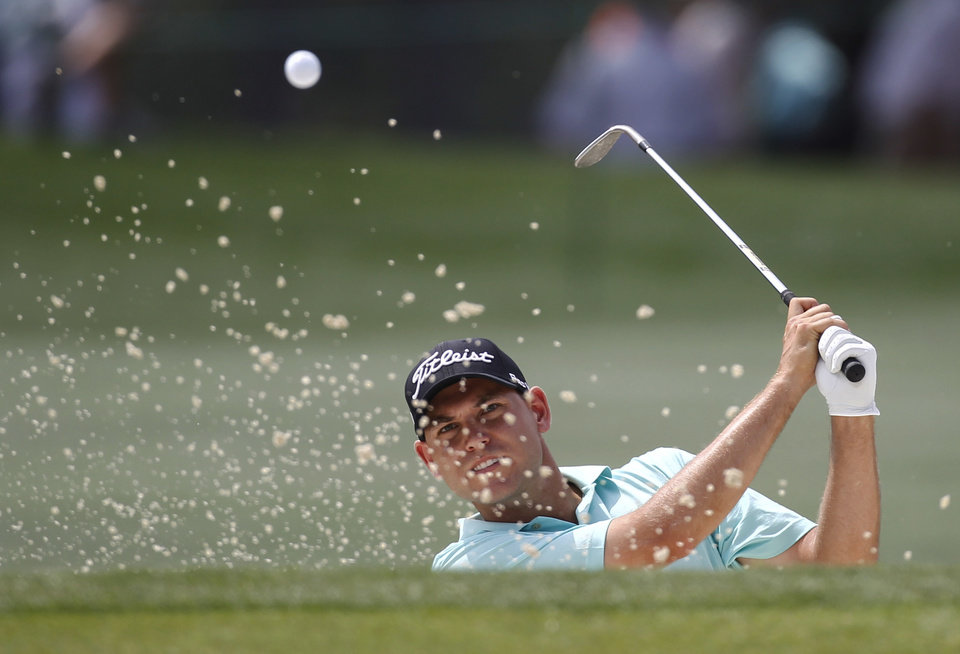 Bill Haas hits out of the sand on the 17th hole during a practice round for the Masters golf tournament Tuesday, April 3, 2012, in Augusta, Ga. (AP Photo/Chris O'Meara)