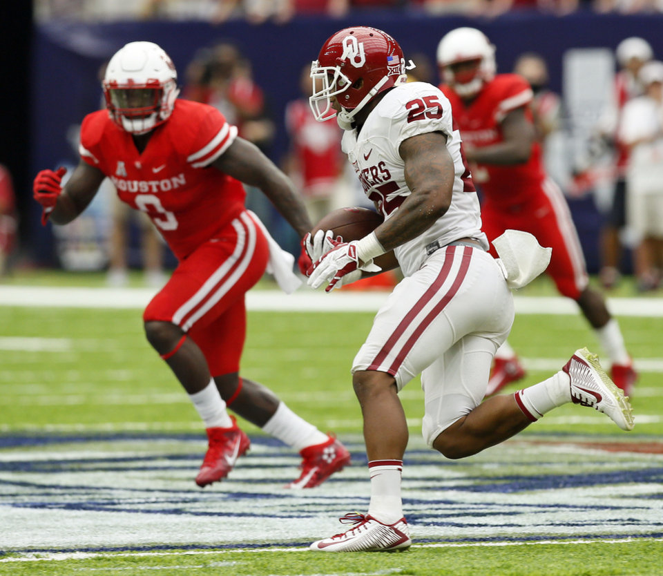 Photo - Oklahoma's Joe Mixon (25) carries the ball during the AdvoCare Texas Kickoff college football game between the University of Oklahoma Sooners (OU) and the Houston Cougars at NRG Stadium in Houston, Saturday, Sept. 3, 2016. Houston won 33-23. Photo by Nate Billings, The Oklahoman