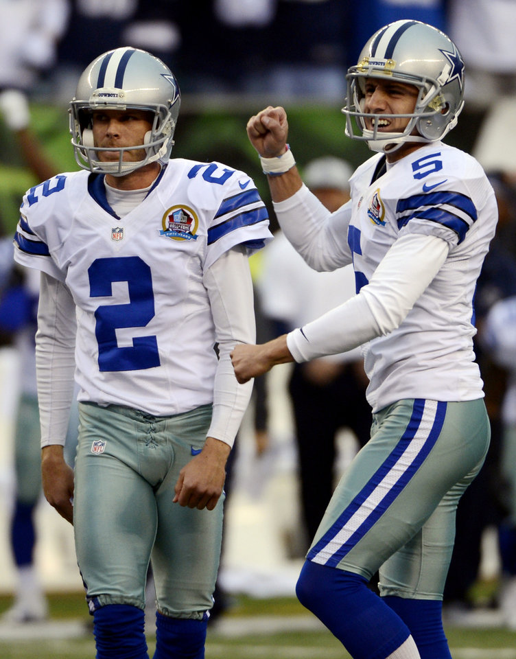 Photo - Dallas Cowboys kicker Dan Bailey (5) reacts after making a 40-yard field goal in the final seconds of the fourth quarter of their NFL football game to give them a 20-19 win over the Cincinnati Bengals, Sunday, Dec. 9, 2012, in Cincinnati. Holder Brian Moorman (2) watches. (AP Photo/Michael Keating)