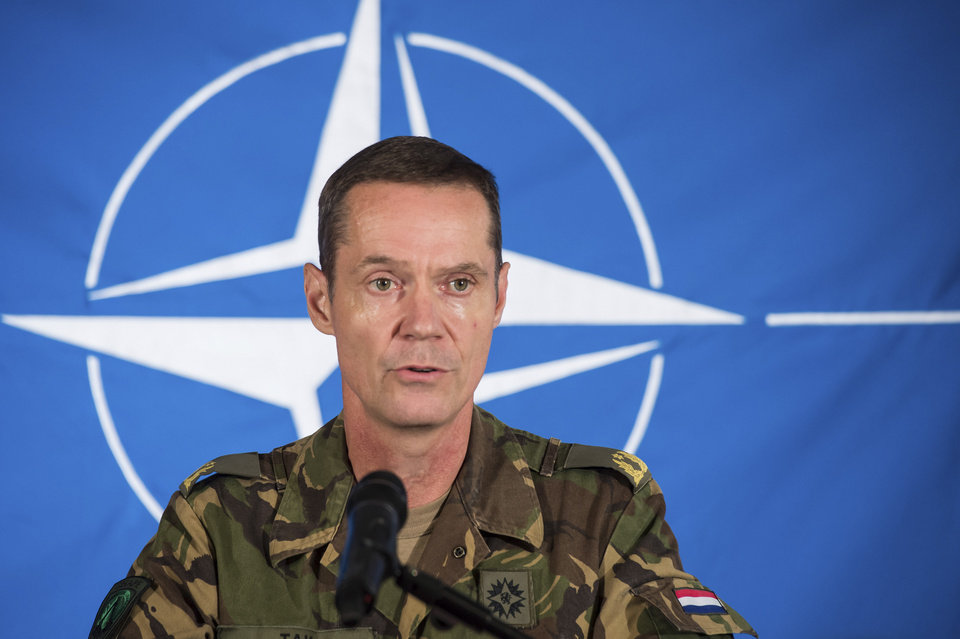 Photo - Dutch Brigadier-General Nico Tak, Director of the Comprehensive Crisis and Operations Management Centre at SHAPE  (Supreme Headquarters Allied Powers Europe) speaks during a media conference at SHAPE headquarters in Mons, Belgium on Thursday,  Aug. 28, 2014. A top NATO official said on Thursday that at least 1,000 Russian troops have poured into Ukraine with sophisticated equipment. Ukrainian President Petro Poroshenko cancelled a trip to Turkey on Thursday and called an emergency meeting of his security council. (AP Photo/Geert Vanden Wijngaert)