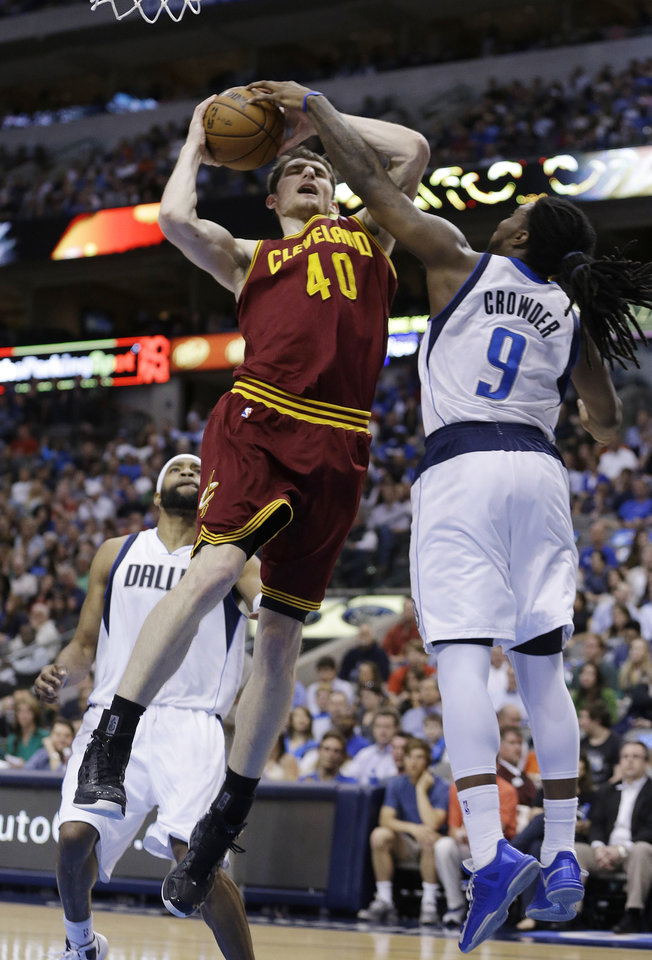 Photo - Cleveland Cavaliers center Tyler Zeller (40) is fouled by Dallas Mavericks forward Jae Crowder (9) during the first half of an NBA basketball game Friday, March 15, 2013, in Dallas. (AP Photo/LM Otero)