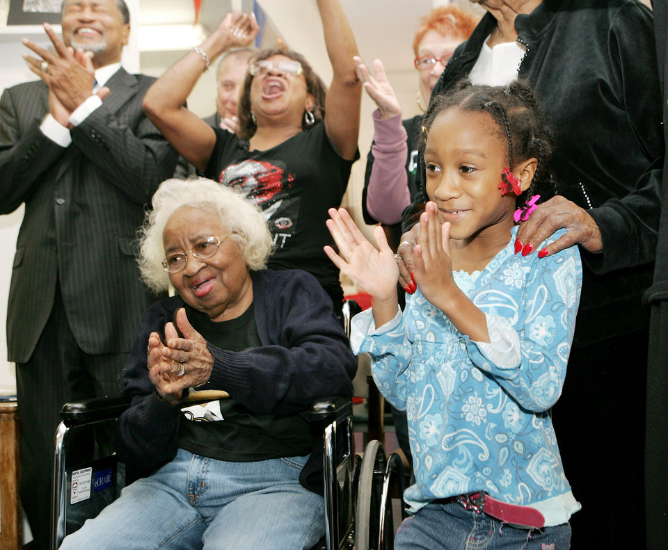"Civil rights pioneer Clara Luper reacts to the inauguration of President Barack Obama. Luper was watching TV with Councilman Ronald ""Skip"" Kelly, her daughter Marilyn Hildreth and 9-year-old Alexia Grant at the Freedom Center at NE 26th and Martin Luther King Avenue in Oklahoma City , Okla. January  20, 2009.  BY STEVE GOOCH, THE  OKLAHOMAN."