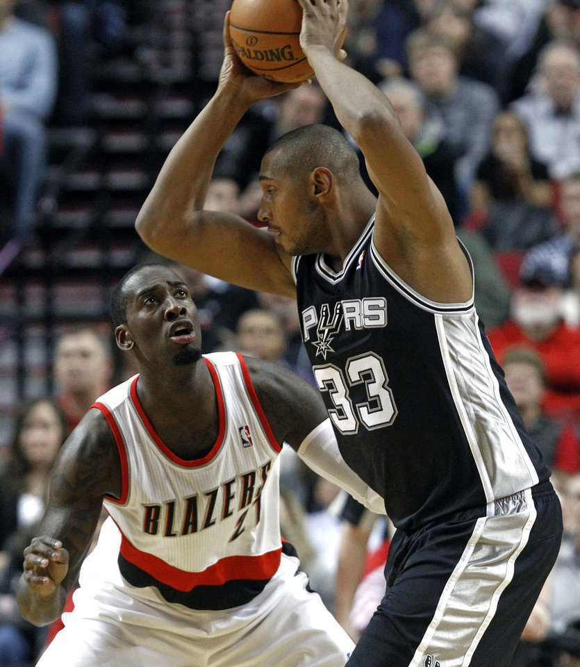 Portland Trail Blazers center J.J. Hickson, left, defends San Antonio Spurs center Boris Diaw, from France, during the first half of their NBA basketball game in Portland, Ore., Saturday, Nov. 10, 2012. (AP Photo/Don Ryan)