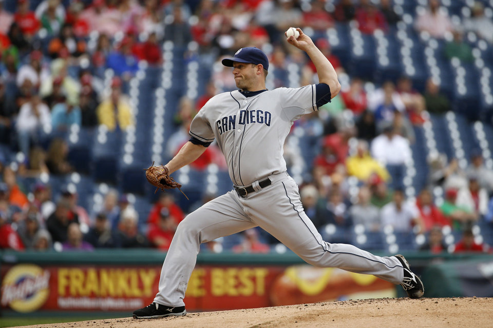 Photo - San Diego Padres' Eric Stults pitches during the first inning of a baseball game against the Philadelphia Phillies, Thursday, June 12, 2014, in Philadelphia. (AP Photo/Matt Slocum)