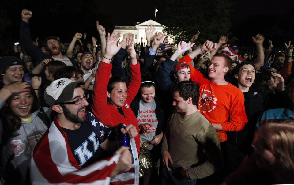 Photo - A crowd outside the White House in Washington, cheer Sunday, May 1, 2011, upon hearing the news that terrorist leader Osama bin Laden is dead. (AP Photo/Manuel Balce Ceneta) ORG XMIT: WHMC102