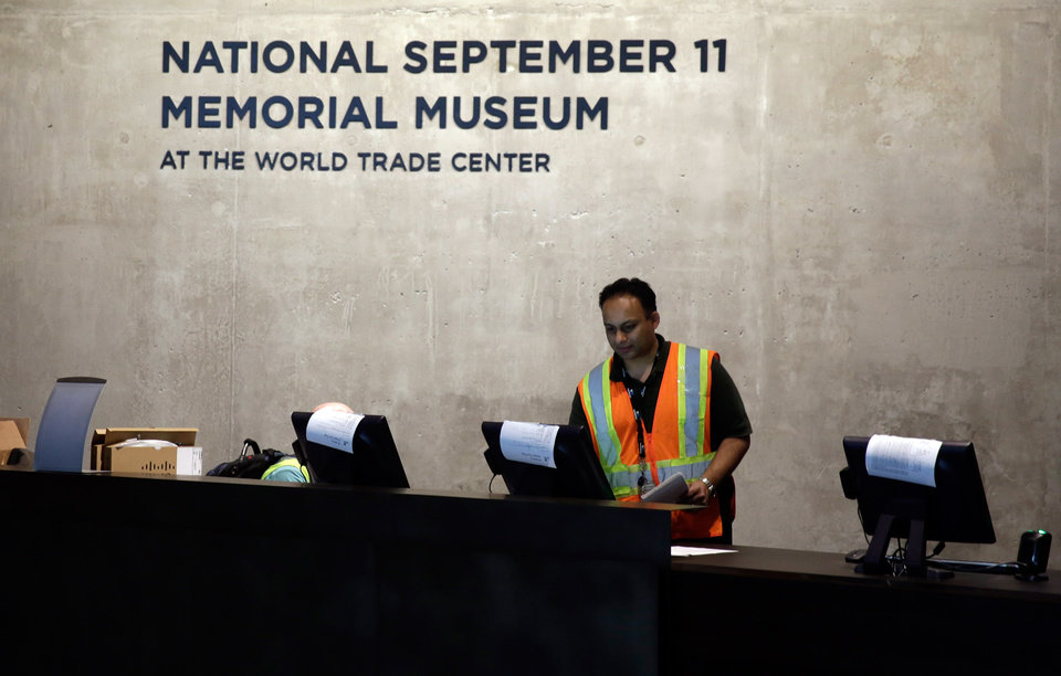 Photo - A technician readies computers at the National Sept. 11 Memorial Museum, Wednesday, May 14, 2014, in New York. The museum is a monument to how the Sept. 11 terror attacks shaped history, from its heart-wrenching artifacts to the underground space that houses them amid the remnants of the fallen twin towers' foundations. It also reflects the complexity of crafting a public understanding of the terrorist attacks and reconceiving ground zero.  (AP Photo)