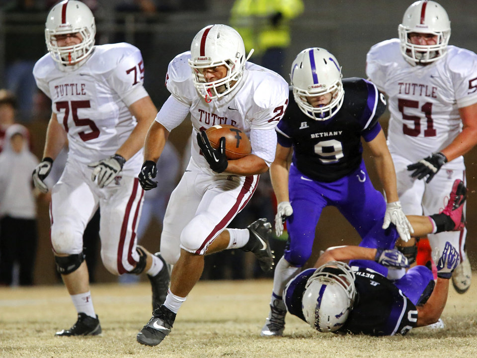 Tuttle running back Morgan Neal gets loose for a touchdown in the third quarter of Friday night�s Class 3A playoff game against Tuttle. The score was not available at press time. Visit NewsOK.com/Varsity for coverage. Photo by Jim Beckel, The Oklahoman