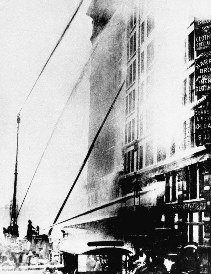 FILE - In this March 25, 1911 file photo, firefighters work to put out the fire at the Triangle Shirtwaist Company in New York's Greenwich Village neighborhood. The fire that raced through a garment factory on Saturday,  Nov. 24, 2012 in Bangladesh and killed 112 workers bore eerie echoes of another inferno that burned more than a century ago: the Triangle Shirtwaist factory fire in New York City.  (AP Photo/File)