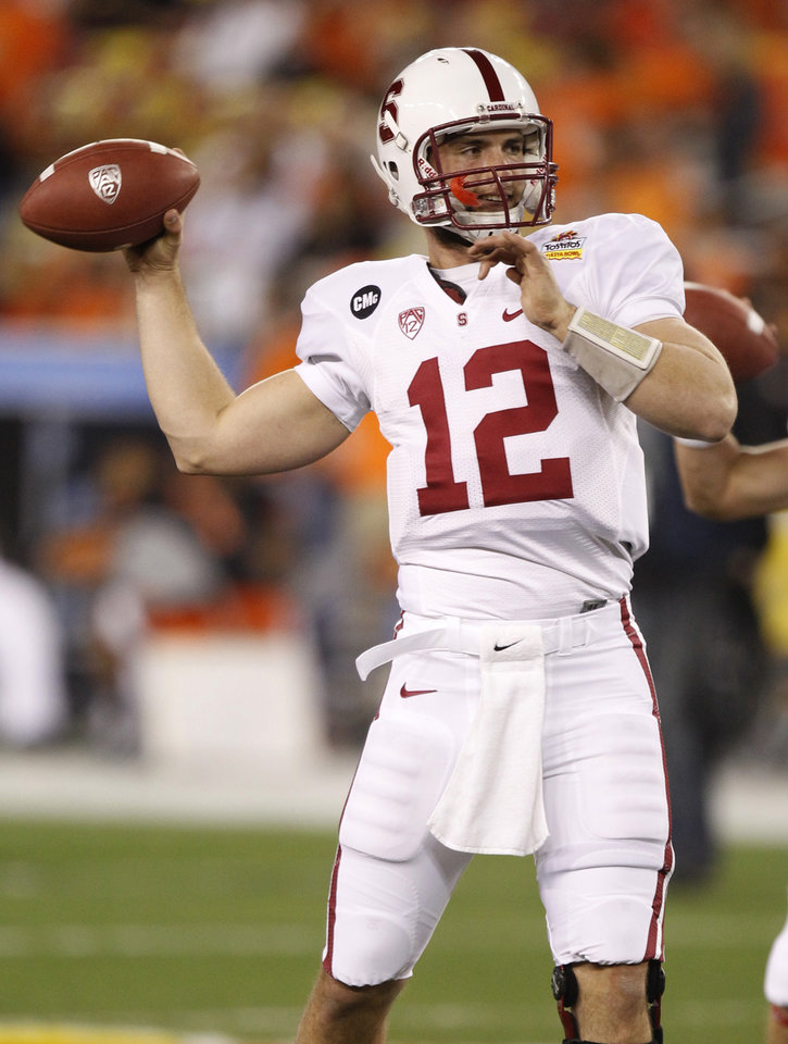 Photo - Stanford quarterback Andrew Luck warms up prior to the Fiesta Bowl NCAA college football game against Oklahoma State Monday, Jan. 2, 2012, in Glendale, Ariz. (AP Photo/Paul Connors)