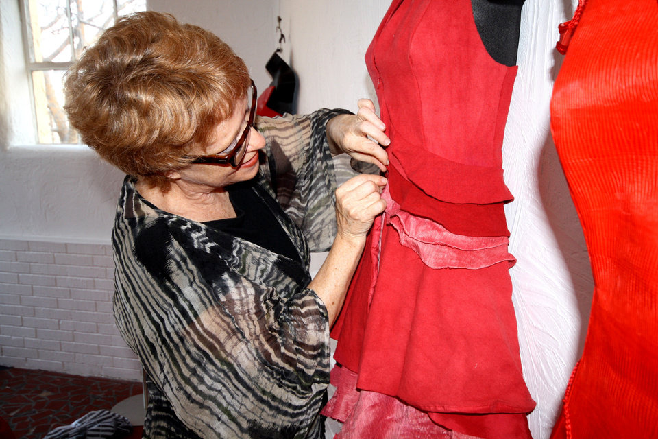Dr. Mary Ruppert-Stroescu, Assistant Professor of Apparel Design and Textile Science, works on a red dress for National Wear Red for Women Day. Photo provided.      <strong></strong>