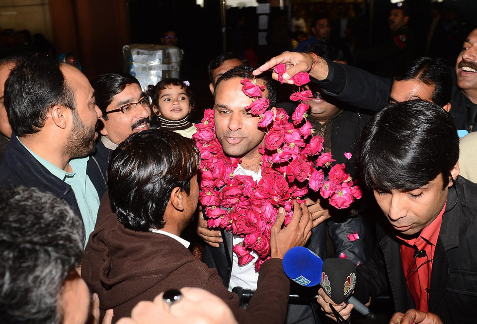 "In this picture taken on Thursday, Dec. 27, 2012, Pakistani fans receive Muhammad Shahid Nazir, center, who sings ""One Pound Fish,"" upon his arrival from London at Lahore airport in Pakistan. The 31-year-old Pakistani fishmonger catapulted to fame in recent weeks in the unlikeliest of circumstances: while hawking frozen snapper and mackerel for one British pound ($1.61) at Queens Market in London. �One Pound Fish changed my whole life,� said Nazir, who returned to Pakistan to a hero�s welcome and has been inundated with requests to perform and do advertisements. �I am so happy now.�(AP Photo/Hamza Ali)"