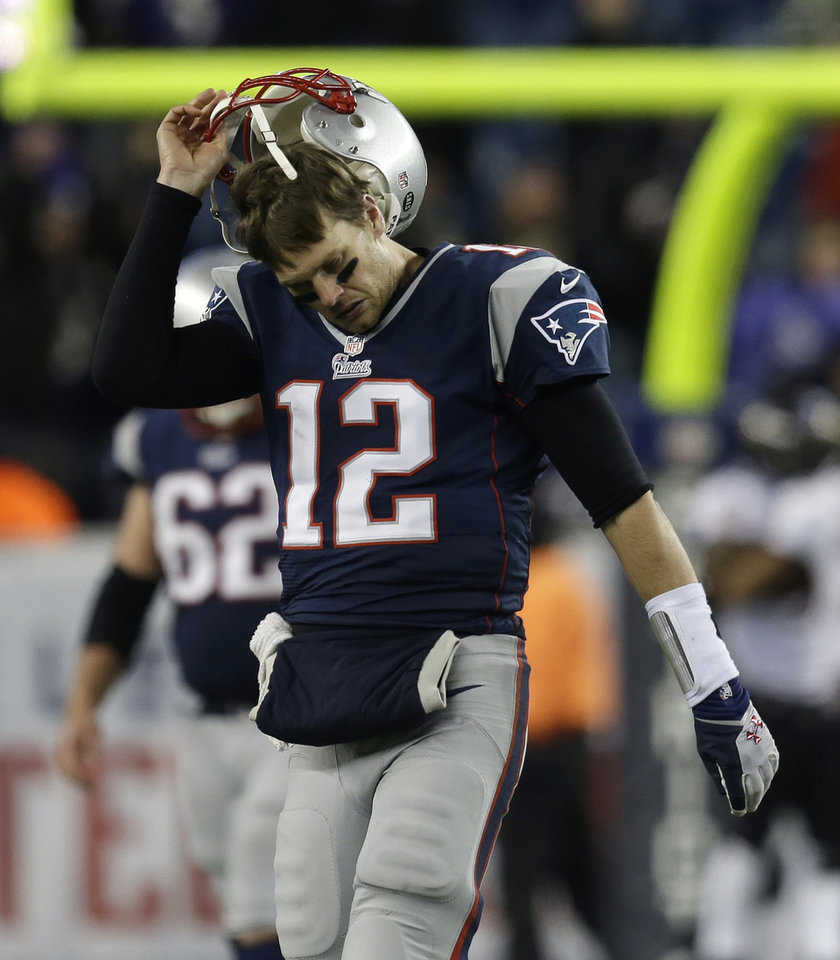 New England Patriots quarterback Tom Brady takes off his helmet following an interception during the second half of the NFL football AFC Championship football game against the Baltimore Ravens in Foxborough, Mass., Sunday, Jan. 20, 2013.  The Ravens won 28-13 to advance to Super Bowl XLVII. (AP Photo/Steven Senne)