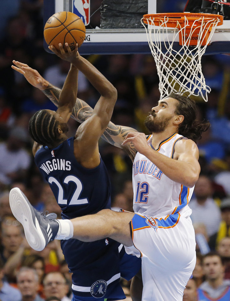 Photo -  The Thunder's Steven Adams defends against Minnesota's Andrew Wiggins during an October game. [PHOTO BY NATE BILLINGS, THE OKLAHOMAN]