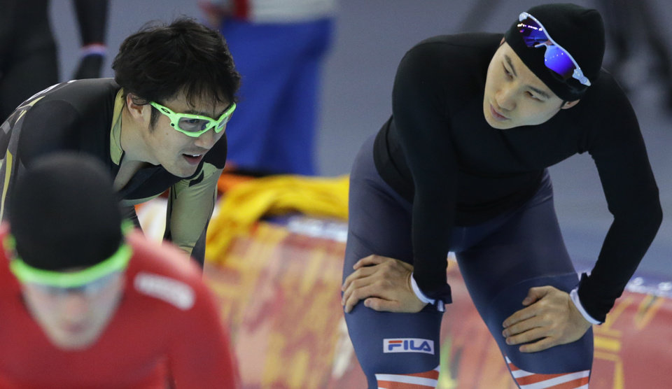Photo - CORRECTS NAME OF SOUTH KOREAN SPEEDSKATER - South Korean speedskater Lee Kang-seok, right, and Joji Kato of Japan interact between training at the Adler Arena Training Center during the 2014 Winter Olympics in Sochi, Russia, Friday, Feb. 7, 2014. (AP Photo/Matt Dunham)