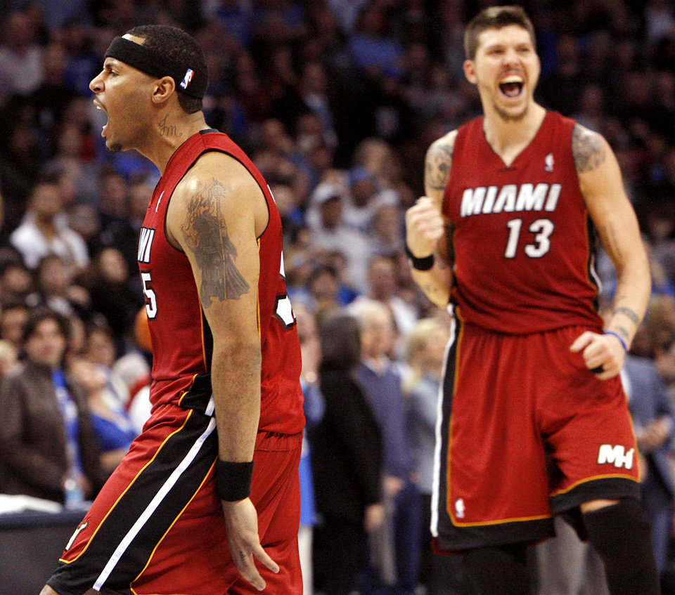 Photo - Miami's Eddie House (left) and Mike Miller celebrate the go-ahead basket scored by House with 22 seconds left in their NBA basketball game against the Oklahoma City Thunder at the OKC Arena in Oklahoma City on Thursday, Jan. 30, 2011. The Heat beat the Thunder 108-103. Photo by John Clanton, The Oklahoman