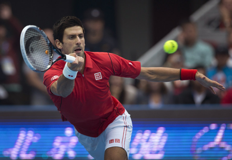 Photo - Novak Djokovic of Serbia returns a shot to Rafael Nadal of Spain during the final of the China Open tennis tournament at the National Tennis Stadium in Beijing, China Sunday, Oct. 6, 2013. (AP Photo/Andy Wong)