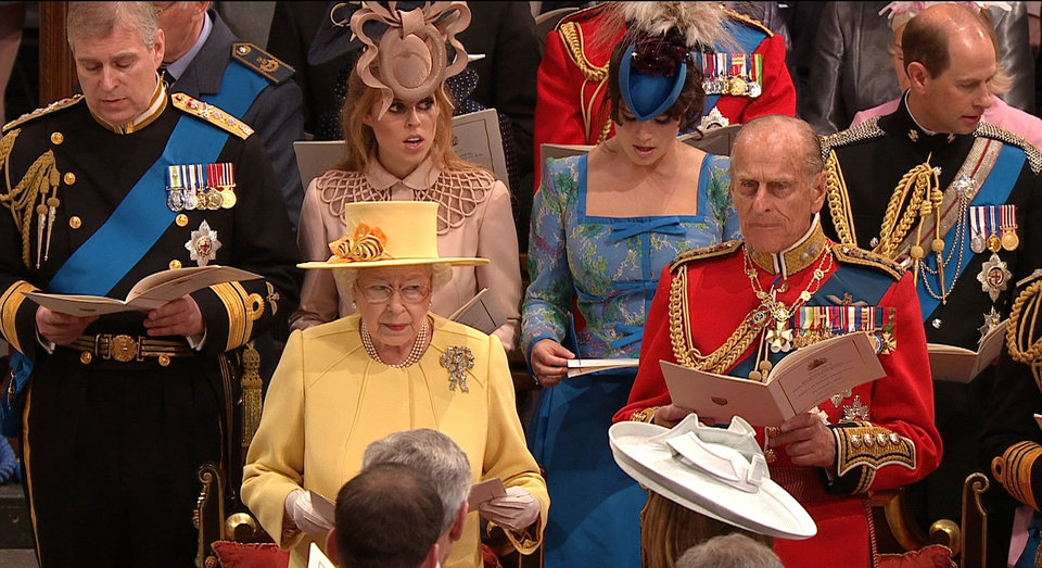 Photo - In this image taken from video, Front row left to right, Britain's Queen Elizabeth II and Britain's Prince Philip. Back row left to right, Britain's Prince Andrew, Britain's Princess Beatrice, Britain's Princess Eugenie, and Britain's Prince Edward sing during the ceremony at Westminster Abbey for the Royal Wedding in London on Friday, April, 29, 2011. (AP Photo/APTN) EDITORIAL USE ONLY NO ARCHIVE PHOTO TO BE USED SOLELY TO ILLUSTRATE NEWS REPORTING OR COMMENTARY ON THE FACTS OR EVENTS DEPICTED IN THIS IMAGE ORG XMIT: RWVM188